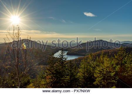 Beautiful sun star from summit of Owlshead Mountain, Vermont USA - Stock Photo