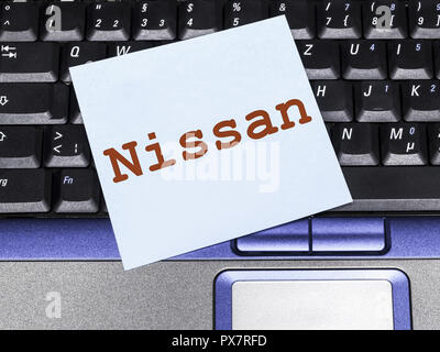 Memo note on notebook, Nissan - Stock Photo