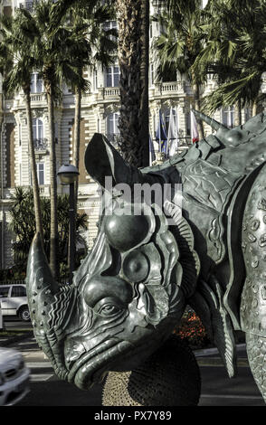 Cannes, sculpture of rhino in front of Hotel Carlton at Croisette, France, Cote d Azur - Stock Photo