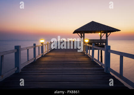 Landscape of Wooded bridge in the port between sunset. - Stock Photo