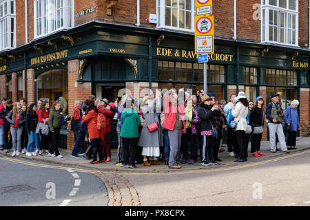 Tourists gather on the corner of Trumpington Street to take photos of St Botolph's Church, Cambridge, UK - Stock Photo