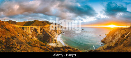 Scenic panoramic view of California Central Coast with historic Bixby Creek Bridge along world famous Highway 1 in beautiful golden evening light at s - Stock Photo