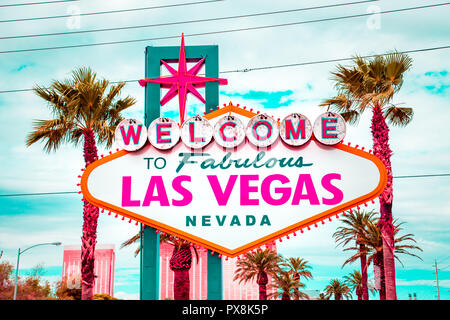 Classic view of Welcome to Fabulous Las Vegas sign at the south end of world famous Las Vegas strip on a beautiful sunny day with blue sky and clouds, - Stock Photo