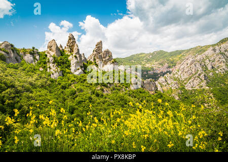 Panoramic view of famous Lucan Dolomites with beautiful mountain village of Castelmezzano in summer, Basilicata, Italy - Stock Photo