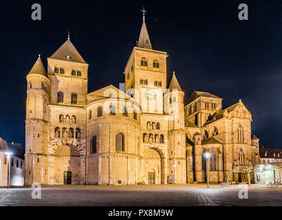 Beautiful view of famous Trierer Dom (High Cathedral of Trier) illuminated at night, Trier, Germany - Stock Photo