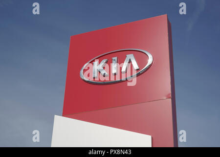 A pylon sign outside a KIA Motors car dealership in the UK - Stock Photo
