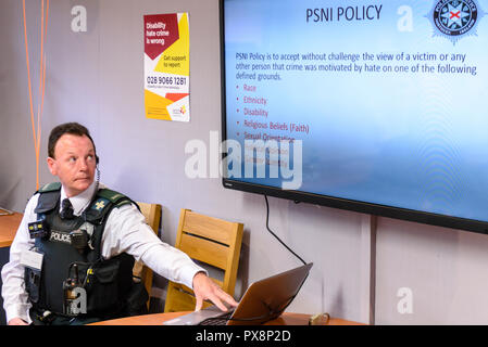 Belfast, Northern Ireland. 16/10/2016 - A police officer delivers a presentation on Hate crime awareness. - Stock Photo