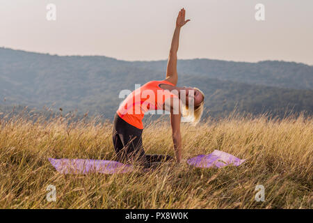 woman in yoga camel posture ustrasana on white