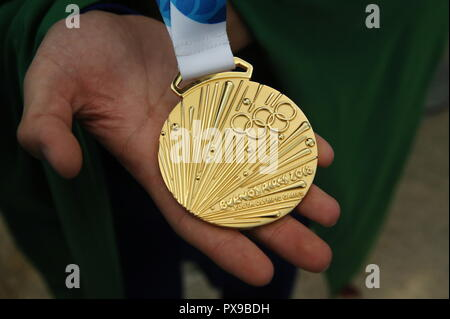 Russia. 20th Oct, 2018. MOSCOW REGION, RUSSIA - OCTOBER 20, 2018: A gold medal of the 3rd Summer Youth Olympic Games during a welcome ceremony for the Russian delegation returning from Buenos Aires, Argentina, at Sheremetyevo International Airport. Vladimir Gerdo/TASS Credit: ITAR-TASS News Agency/Alamy Live News - Stock Photo