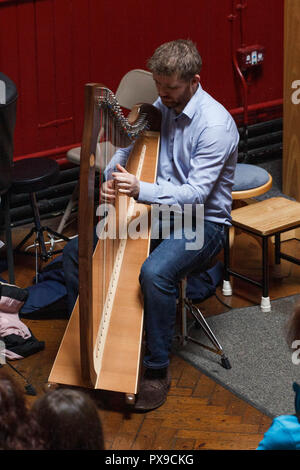 Cork, Ireland. 20th Oct, 2018.  Performing here is Oisin Morrison.  National Harp Day/ Lá na Cruite, Crawford Art Gallery, Cork City. National Harp Day/ Lá na Cruite took place today with many events in venues throughout the country. Crawford Art Gallery was one of the venues to host an event. The gallery saw Damhnait Sweeny, Oisin Morrison and Orla Busteed performing as well as a variety of other harpists who played throughout the gallery during the day. Credit: Damian Coleman/Alamy Live News. - Stock Photo