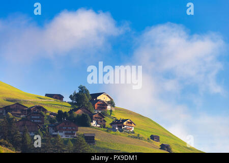 Traditional houses in Longiarù, Badia Valley, South Tyrol, Dolomites, Italy, Europe. - Stock Photo