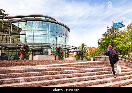 14 September 2018: Gothenburg, Sweden - Young woman carrying a bag, walking up the steps to Gothenburg University. - Stock Photo