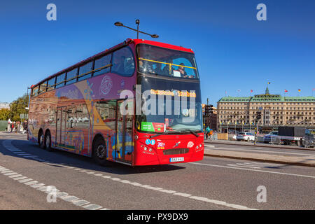 16 September 2018: Stockholm, Sweden - Red double decker tour bus in central city, with clear blue sky. - Stock Photo