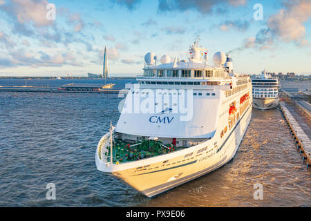 18 September 2018: St Petersburg, Russia - Cruise ships at the Cruise Terminal, with the tallest building in Europe in the background, the Gazprom Tow - Stock Photo