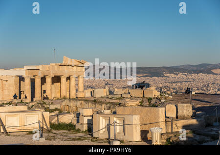 Ruins of Parthenon temple with monumental gateway Propylaea in the Acropolis of Athens, Attica, Greece - Stock Photo