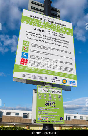 Car park tariff and charges sign in a British car park in Churchill Parade, Rustington, West Sussex, England, UK. - Stock Photo