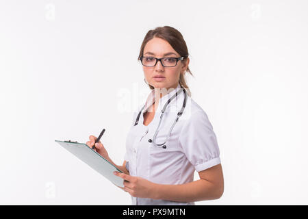 Female medicine doctor hand holding pen writing something on clipboard on white background. - Stock Photo