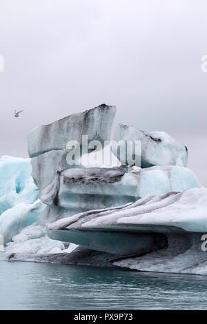 Calved ice from the Breidamerkurjokull glacier in Jökulsárlón glacial lagoon, southeast coast of Iceland. - Stock Photo