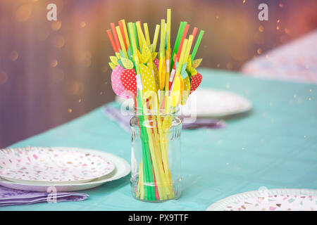 Birthday party table with colorful straws - Stock Photo