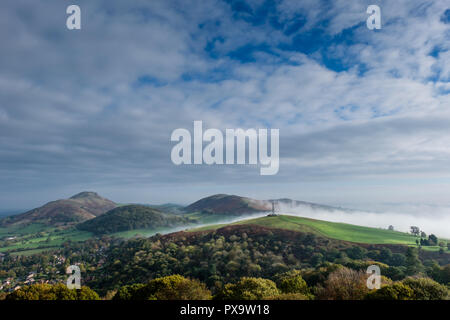 Mist swirls around Hazler Hill, with Helmeth Hill, Caer Caradoc and Hope Bowdler in the clear, Church Stretton, Shropshire - Stock Photo