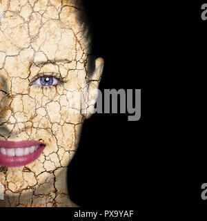 Beauty concept - woman face covered with cracked surface - symbol of dry skin - Stock Photo