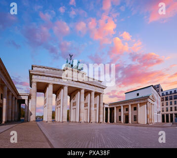 Brandenburg Gate (Brandenburger Tor) in Berlin, Germany, on a sunset, panoramic image - Stock Photo