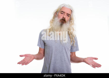 Studio shot of senior bearded man looking confused - Stock Photo