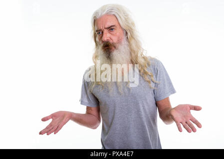 Studio shot of senior bearded man looking to the side and confus - Stock Photo