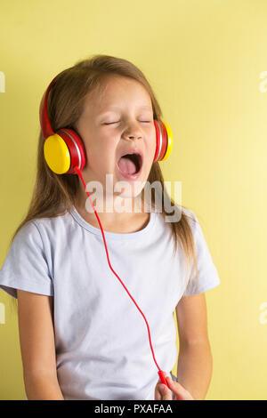 girl in headphones sings - Stock Photo