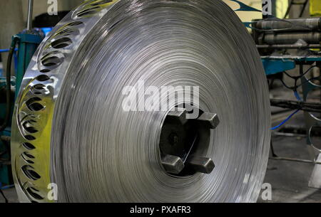 View of finished aluminum sheet rolls in a factory producing semi-finished products. - Stock Photo