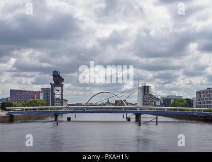 Looking Up river from the Millennium Bridge on the River Clyde and the various Hotels and Entertainment Facilities around Pacific Quay, Glasgow, Scotl - Stock Photo