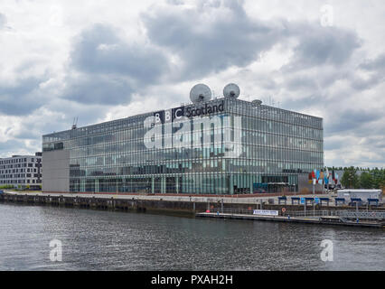 The BBC Scotland Building at Pacific Quay in Glasgow Scotland on a cloudy Summers day in July 2018. - Stock Photo