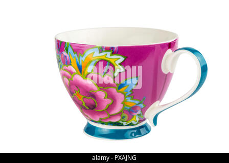 Mug cup for tea or coffee brightly decorated in pink blue and yellow colours - hand painted oriental style cup isolated on white background - Stock Photo