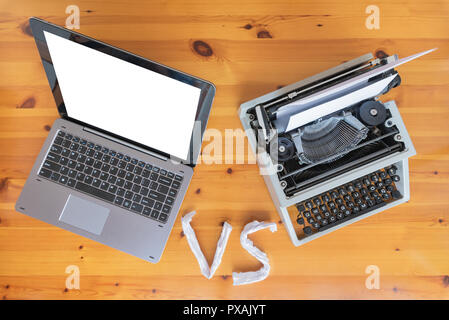 Old typewriter vs new laptop on the table. Concept of technology progress. - Stock Photo