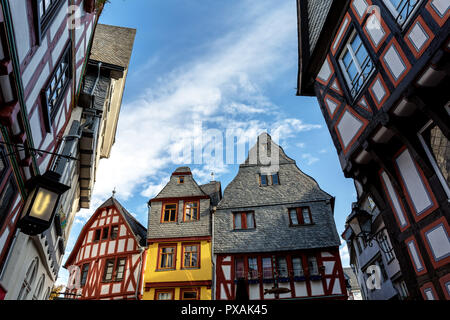 Ancient half-timber houses in Limburg Germany in front of blue sky, low angle view, hdr shot. - Stock Photo