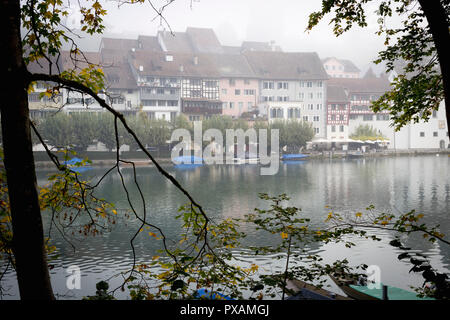 The town of Eglisau reflected on the Rhine River on a foggy morning, Canton of Zurich, Switzerland. - Stock Photo