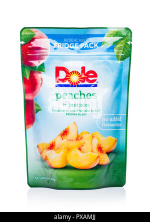 LONDON, UK - OCTOBER 20, 2018: Pack of Dole Peaches in fruit juice on white. Product by Dole - Stock Photo