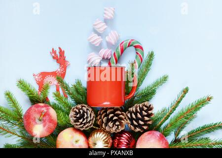 new year and christmas decoration small fir tree branches christmas balls and cones cup with coffee  and murshmallows, sweet and cute composition. Win - Stock Photo