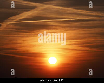 Violent sky at sun set with clouds formation seen from european city of Bielsko-Biala in Poland in 2018 cold spring evening on April - Stock Photo