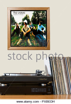Record player and framed album cover The Verve 1997 album Urban Hymns, England - Stock Photo