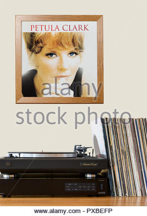 Record player and framed album cover England - Stock Photo