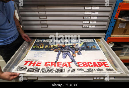 Embargoed to 0001 Monday October 22 A movie poster for the 1963 film The Great Escape during a preview of the forthcoming cinema poster auction at the Prop Store head office near Rickmansworth. - Stock Photo