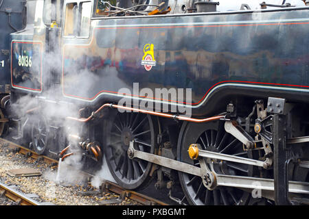 Close-up of coupling gear and driving wheels of 2-6-4T Class Standard 4   No.80136, awaiting departure of its passenger service at Pickering Station. - Stock Photo