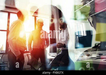 Business people work together in office. Concept of teamwork and partnership. double exposure with light effects - Stock Photo