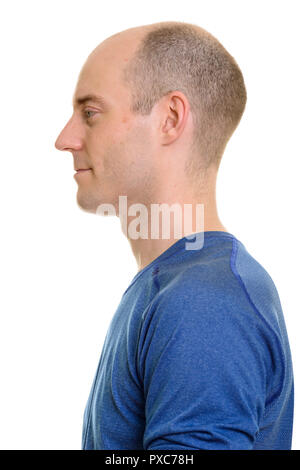 Close up profile view of bald Caucasian man  - Stock Photo