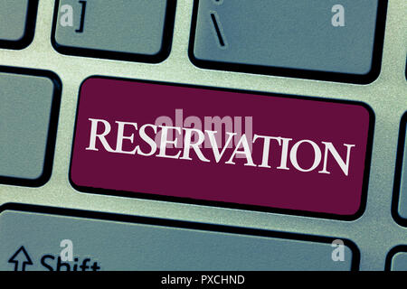 Handwriting text writing Reservation. Concept meaning Arrangement made so a seat somewhere is kept for someone. - Stock Photo