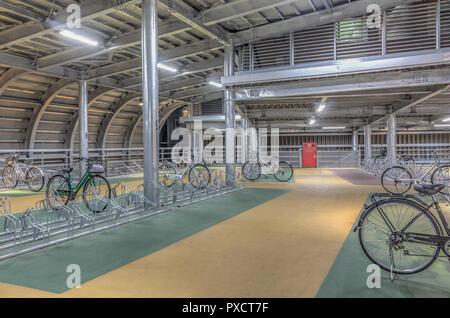 HDR image of modern and stylish indoor bicycle park, Kanazawa, Japan - Stock Photo