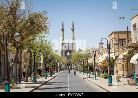 YAZD, IRAN - AUGUST 18, 2016: Jameh mosque, with its distinctive tiles minarets, seen from a nearby street. Jameh mosque is one of the symbols of the  - Stock Photo