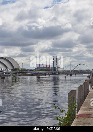 Looking East down from Pacific Quay in Glasgow, with the SEC Armadillo and the Bell and Millennium Footbridges across the River Clyde, Scotland. - Stock Photo