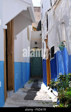 narrow alley in casbah of the udayas, old town of Rabat, Morocco, with blue  and white painted facades at medieval houses - Stock Photo